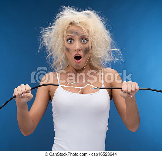 Funny girl having problem with electricity. Electrical shock - csp16523644