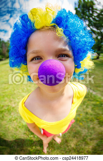 Funny girl in clown wig with blue nose - csp24418977