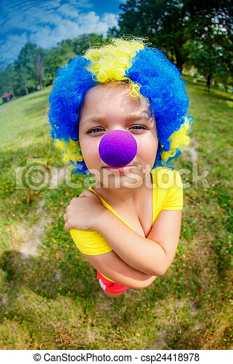 Funny girl in clown wig with blue nose - csp24418978