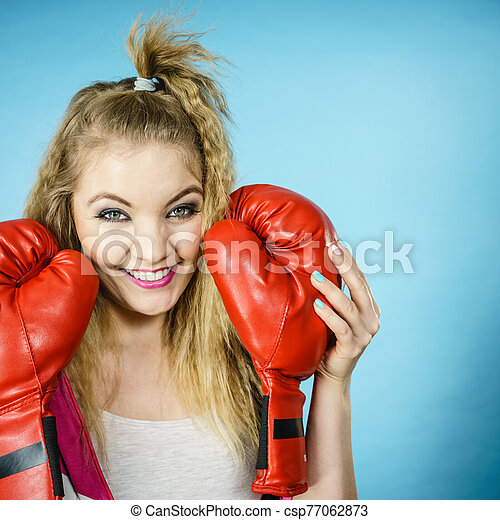 Funny girl with red gloves playing sports boxing - csp77062873