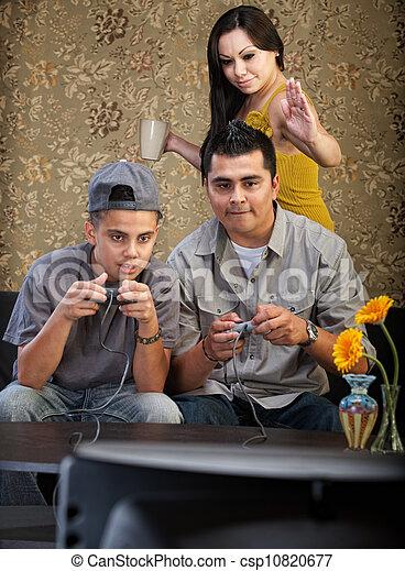 Funny Hispanic Family Playing Video Games - csp10820677