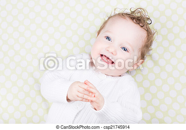 Funny little baby in a white sweater - csp21745914