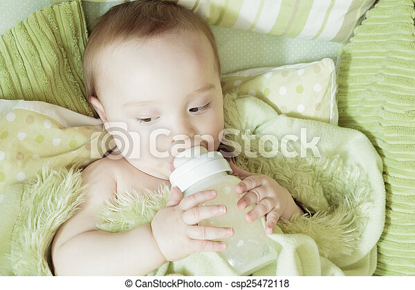 Funny little baby with beautiful standing in a round white crib - csp25472118