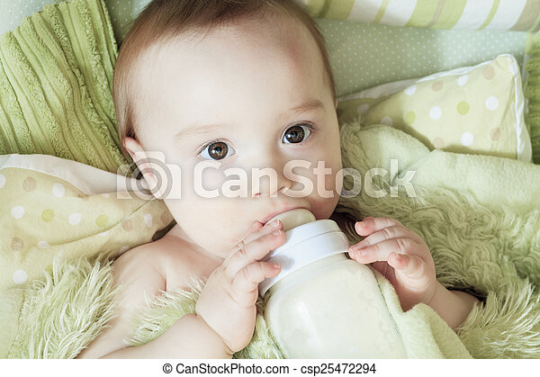 Funny little baby with beautiful standing in a round white crib - csp25472294