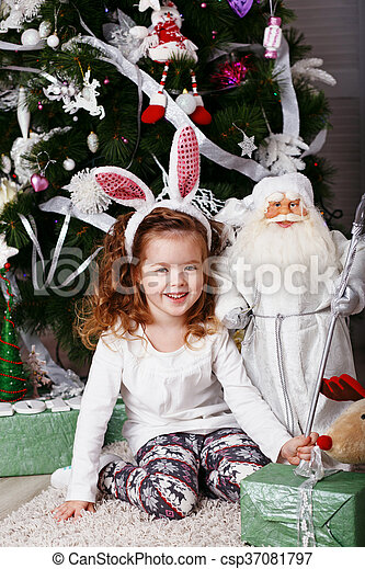 Funny little girl with bunny ears. - csp37081797