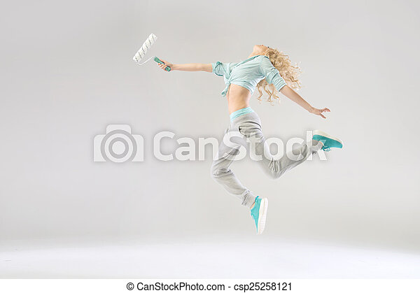 Funny picture of woman holding a roller - csp25258121