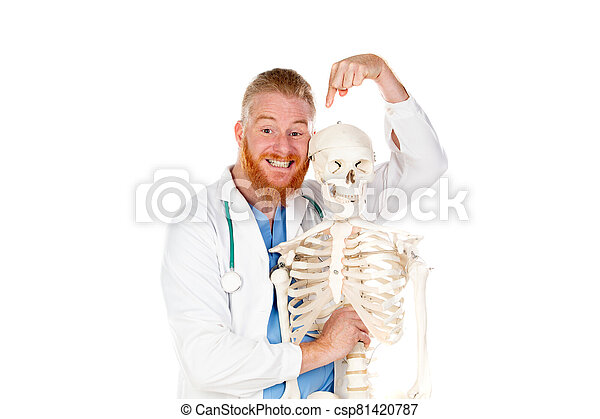 Funny redhead doctor with a skeleton - csp81420787
