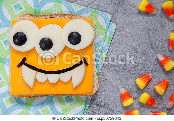 Funny sandwich for kids lunch on a table - csp50729843
