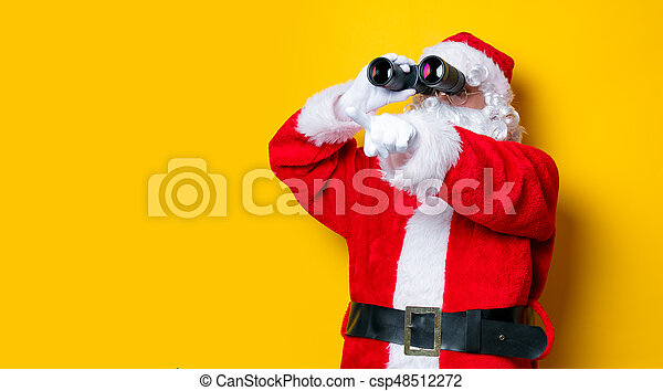 Funny Santa Claus holding binoculars - csp48512272