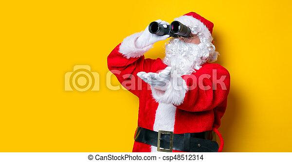 Funny Santa Claus holding binoculars - csp48512314