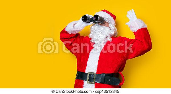 Funny Santa Claus holding binoculars - csp48512345