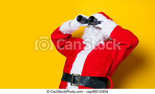 Funny Santa Claus holding binoculars - csp48512404