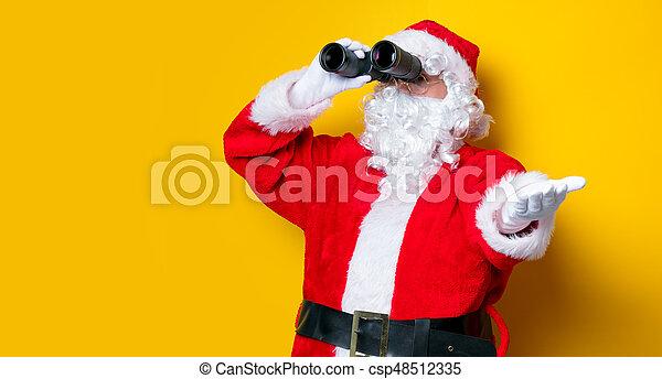 Funny Santa Claus holding binoculars - csp48512335