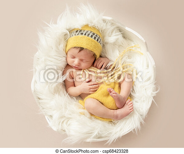 Funny Sleeping Baby In Yellow Romper On Round Cot Funny Sleeping Baby In Yellow Romper With Chicken Toy On Round Cot Top