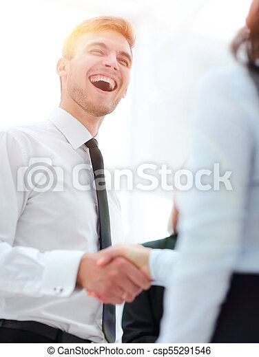 funny smiling businessman shaking hands with his partner. - csp55291546