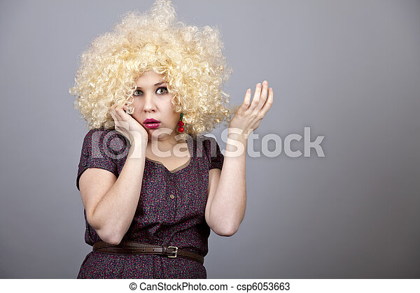 Funny woman in wig. - csp6053663