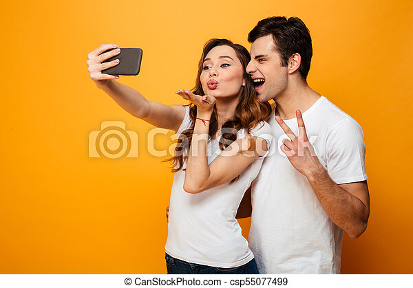 Funny Young Lovely Couple Posing Together While Making Selfie