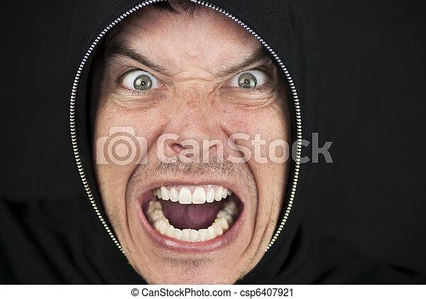 Furious Man Looks To Camera - csp6407921