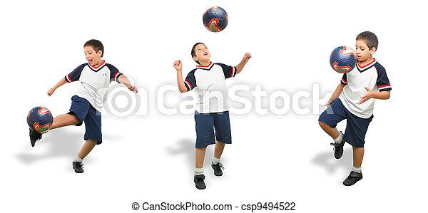 Un chico jugando al fútbol aislado - csp9494522