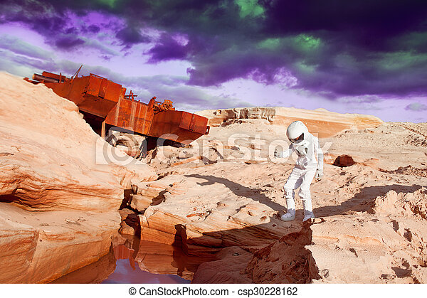 futuristic astronaut on another planet, Mars - csp30228162