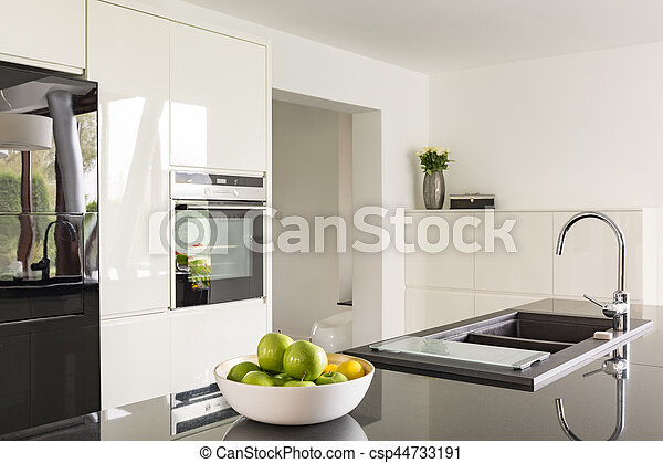 Futuristic high gloss kitchen in white with black worktop. on black with white doors, black with white kitchen floor, black with white drawers,
