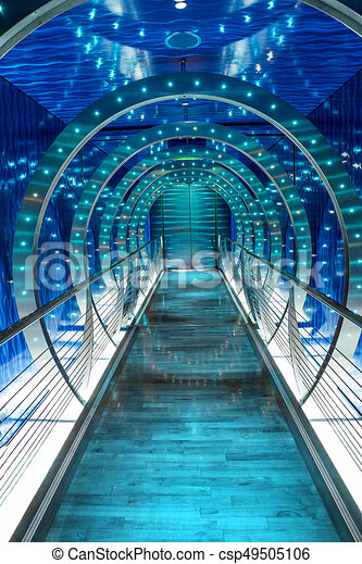 futuristic tunnel background with blue glowing lights perspective