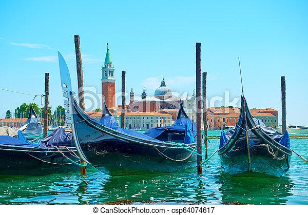 Gondolas Moored en Venecia - csp64074617