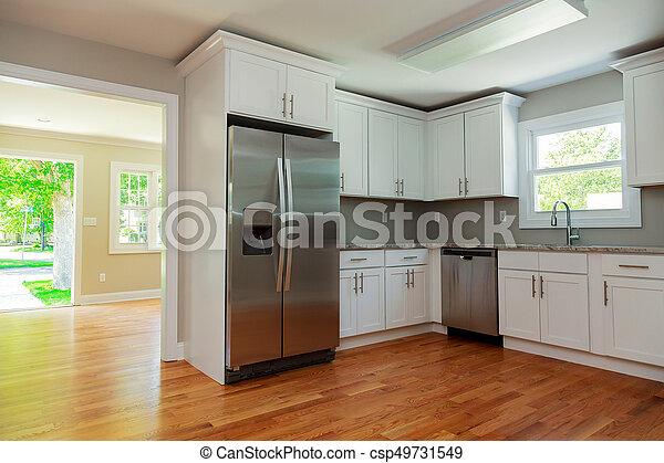 Gabinetes, pisos de madera dura, interior, blanco,... foto de ...