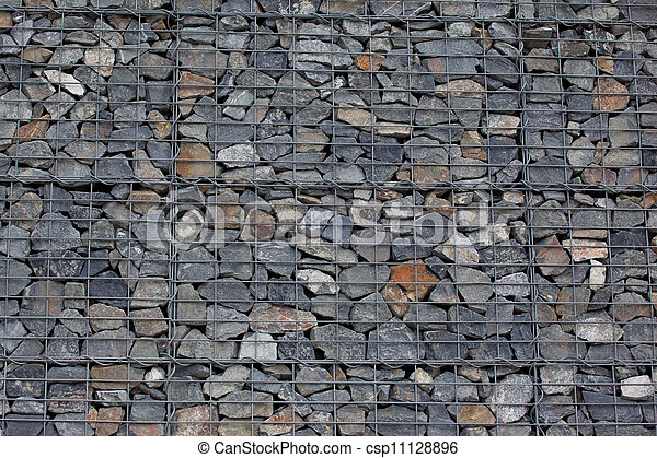 Gabion wall made of grey stones.