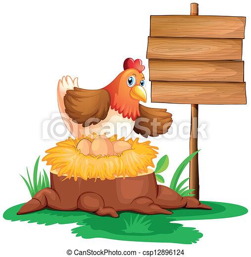 Una gallina poniendo huevos - csp12896124