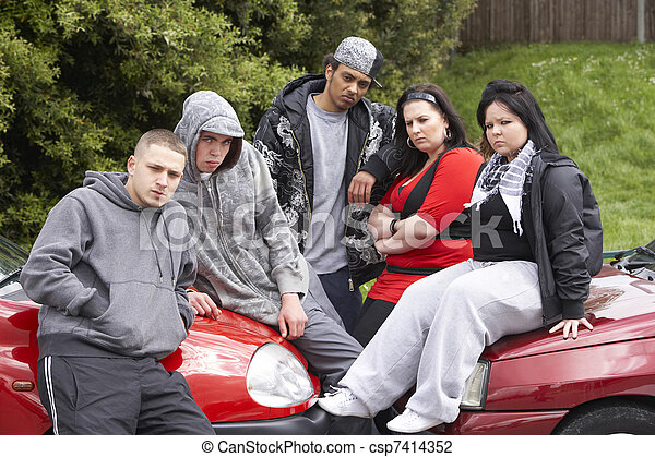 Gang Of Youths Sitting On Cars - csp7414352