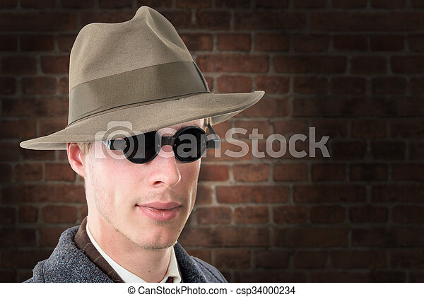 Gangster or FBI agent with a hat and black glasses - csp34000234