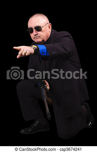 Gangster or Government agent, FBI agent, over a black background - csp3674241