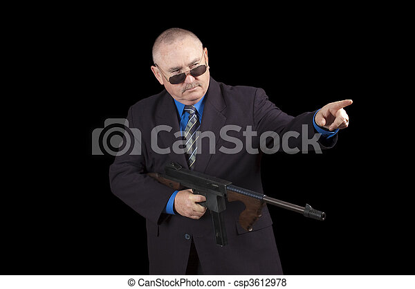 Gangster or Government agent, FBI agent, over a black background - csp3612978
