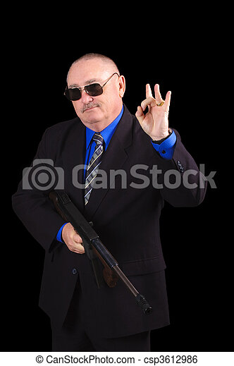 Gangster or Government agent, FBI agent, over a black background - csp3612986