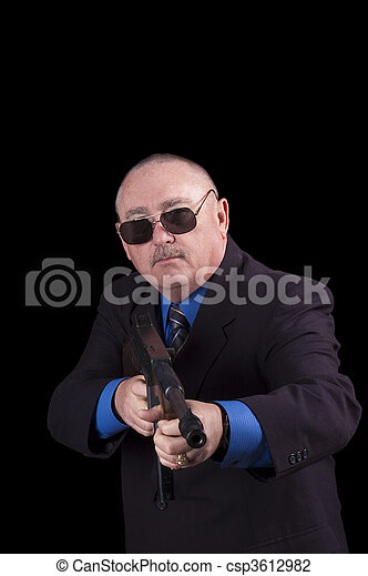 Gangster or Government agent, FBI agent, over a black background - csp3612982