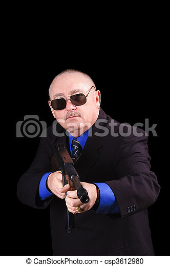 Gangster or Government agent, FBI agent, over a black background - csp3612980