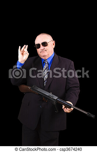 Gangster or Government agent, FBI agent, over a black background - csp3674240