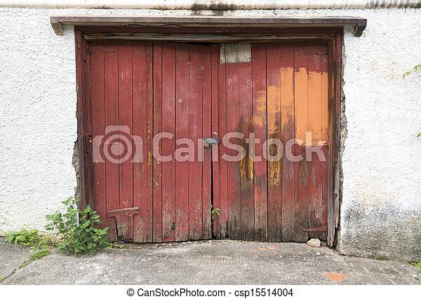 Old Damaged Double Red Wooden Garage Door