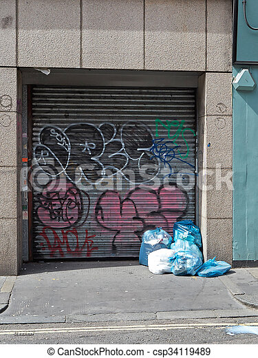 Garbage and graffiti in london - csp34119489