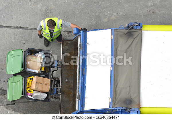 Garbage man loading garbage truck - csp40354471
