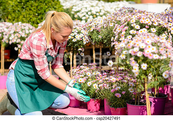 Garden center woman kneeling by potted flowers garden center woman garden center woman kneeling by potted flowers csp20427491 mightylinksfo