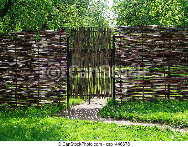A garden door made of sticks by a sunny day & Garden door. A garden door made of sticks by a sunny day.