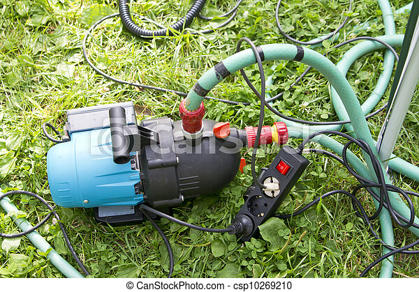Stock Photography of Garden hose and water pump connection in the