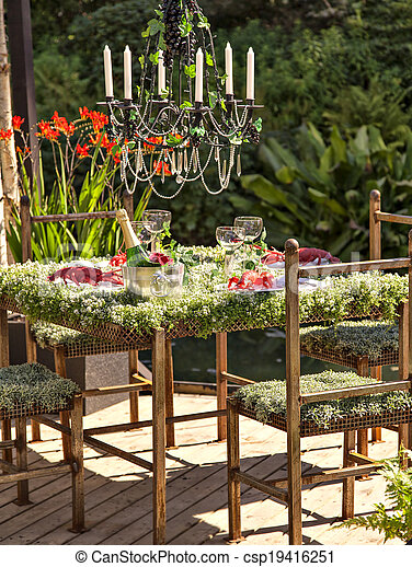 Garden table setting - csp19416251 & Image of an unusual and pitoresque garden table setting. stock ...