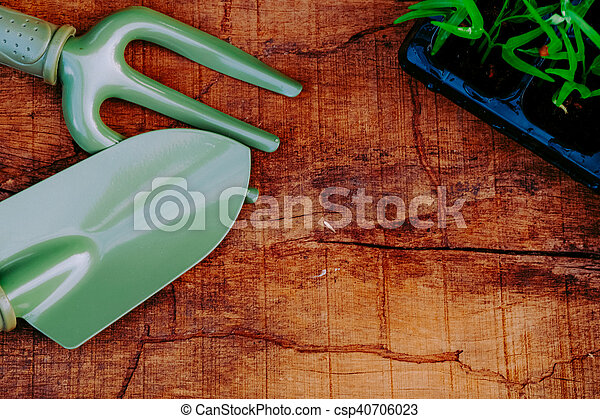 Garden Tools And Sprouts On Wooden Table Top Gardening Trowel And