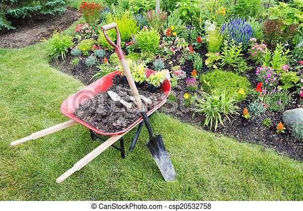 Garden work being done landscaping a flowerbed - csp20532758