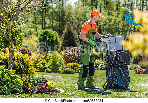 Gardener Cleans Private Yard Area After Routine Maintenance. - csp80863084