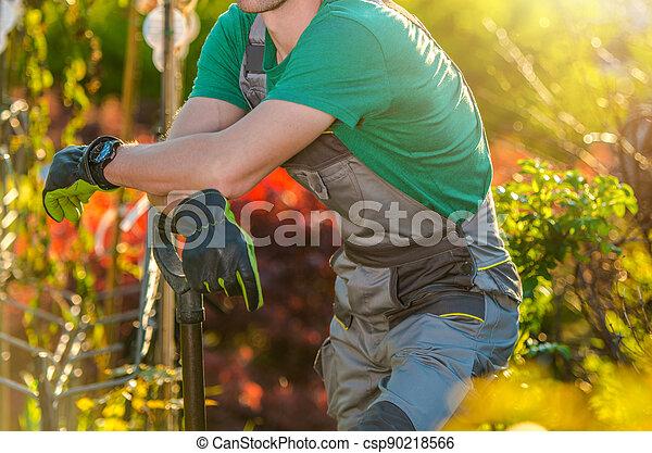 Gardener in His Beautiful Garden - csp90218566