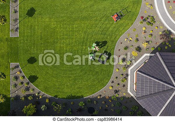 Gardener Maintaining Residential Yard Area. - csp83986414